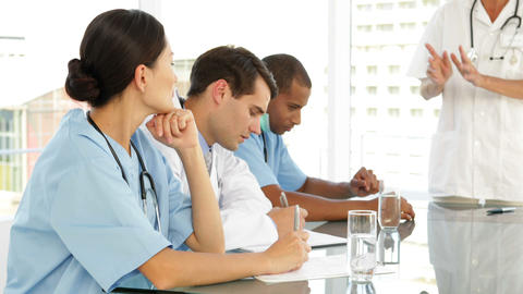 Doctor speaking to her staff during meeting Stock Video Footage