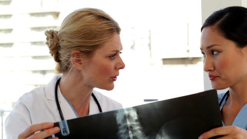 Doctor and nurse looking over xray Footage