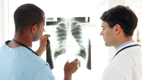 Surgeon and doctor looking over xray together Stock Video Footage