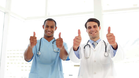Happy surgeon and doctor giving thumbs up Footage