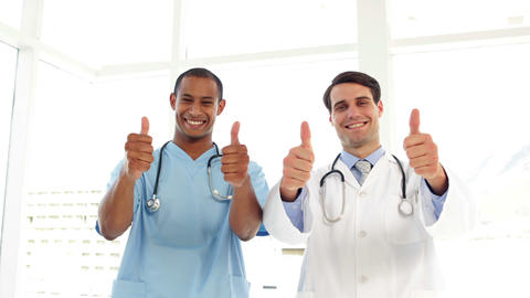 Happy surgeon and doctor giving thumbs up Stock Video Footage