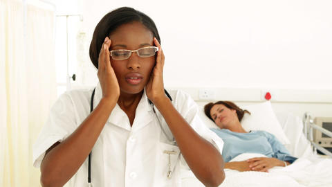 Nurse getting a headache in the ward Stock Video Footage