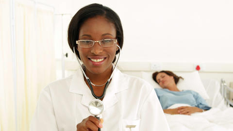 Smiling nurse in the ward holding her stethoscope Stock Video Footage