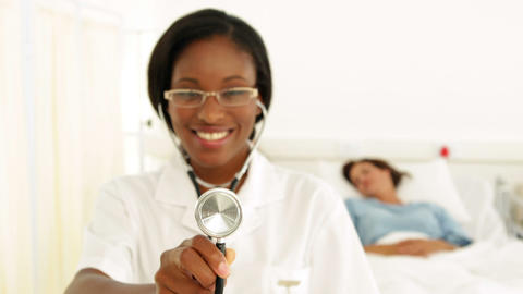 Smiling nurse in the ward holding her stethoscope Footage