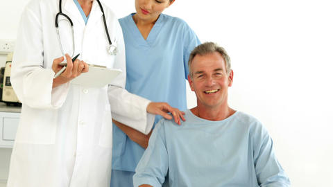 Friendly medical team talking with disabled patient Stock Video Footage