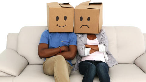 Team sitting on sofa with emoticon boxes on their heads Footage