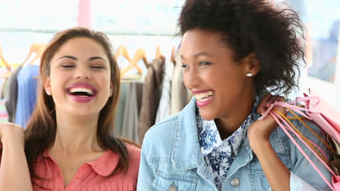 Pretty friends shopping together and smiling at camera Stock Video Footage