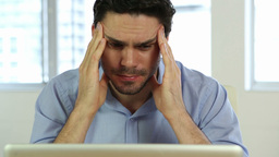 Stressed businessman looking at laptop Stock Video Footage