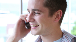 Casual businessman smiling and talking on phone Stock Video Footage