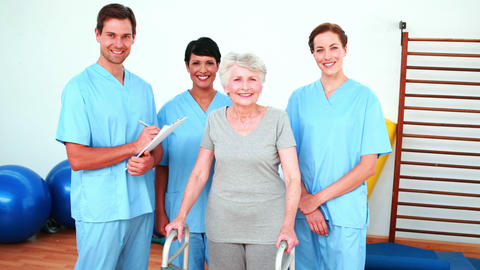 Elderly woman smiling with her physical rehab team Footage