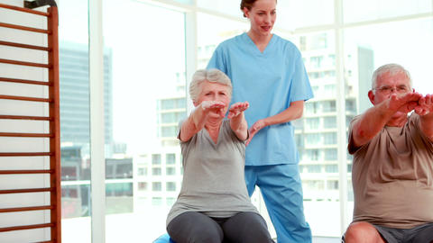 Senior citizens working out with physiotherapist Footage