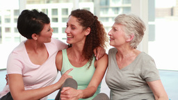 Three happy women smiling at the camera Stock Video Footage