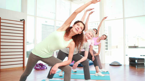 Women stretching at a yoga class Stock Video Footage