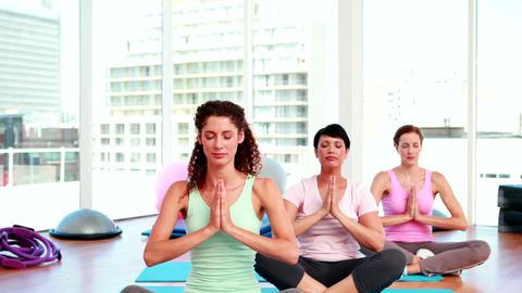 Women doing yoga in fitness studio Stock Video Footage