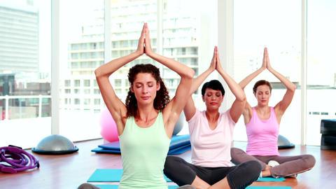Women doing yoga in fitness studio Footage