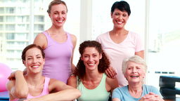 Smiling group of women in fitness studio Stock Video Footage