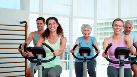 Fitness group doing a spinning class Stock Video Footage