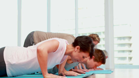Exercise class doing push ups together Stock Video Footage