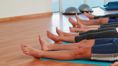 Yoga class lying down in relaxation Stock Video Footage