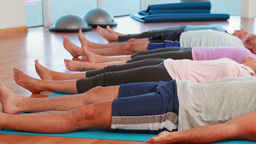 Yoga Class Lying Down In Relaxation stock footage