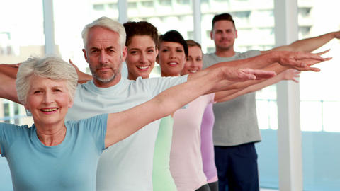 Yoga class stretching out their arms Stock Video Footage