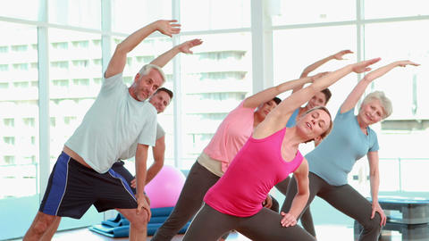 Aerobics class stretching their arms together Stock Video Footage
