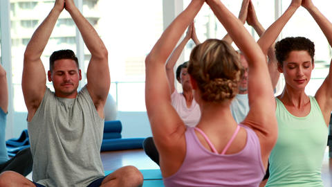 Happy yoga class sitting in lotus position together Stock Video Footage