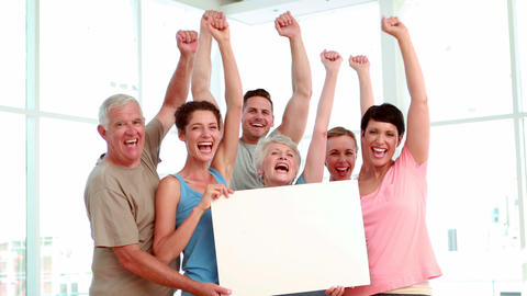 Fitness class holding a white poster an cheering Stock Video Footage