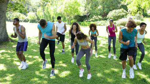 Boot camp class jogging on the spot Stock Video Footage