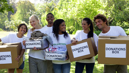 Group of young volunteers holding donation boxes Footage