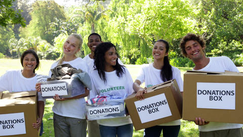 Group of young volunteers holding donation boxes Stock Video Footage