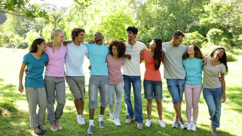 Group of casual young friends smiling at camera Stock Video Footage