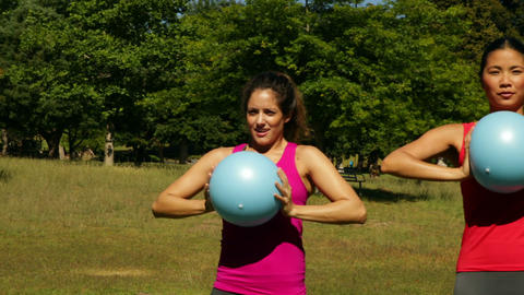 Fitness group working out with medicine balls Stock Video Footage