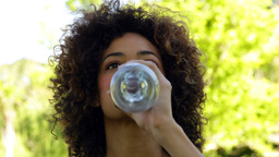 Happy fit brunette taking a drink of water Stock Video Footage