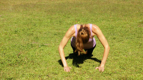 Woman doing push ups in the park Stock Video Footage
