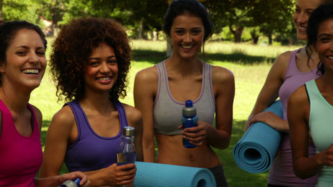 Fitness class smiling at camera before their workout in... Stock Video Footage