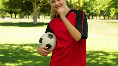 Blonde football player smiling and giving thumbs up to... Stock Video Footage