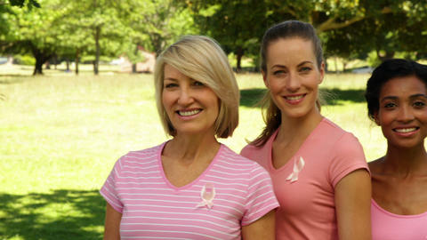 Diverse happy women wearing pink for breast cancer... Stock Video Footage