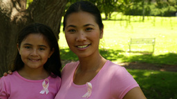 Mother and daughter wearing pink for breast cancer... Stock Video Footage