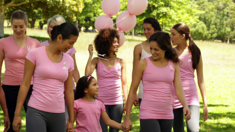Women going on a walk for breast cancer awareness in the park Footage