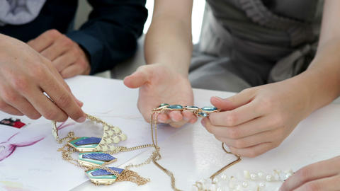 Design team looking at costume jewelry Stock Video Footage