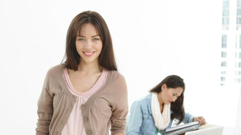 Creative businesswoman smiling at camera with colleague... Stock Video Footage