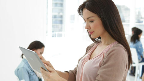 Creative businesswoman using tablet pc with colleagues... Stock Video Footage