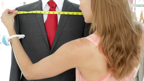 Attractive fashion designer measuring suit on mannequin Stock Video Footage