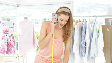 Attractive fashion designer talking on the phone Footage