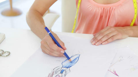 Attractive fashion designer sketching a dress design Stock Video Footage