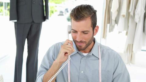 Handsome fashion designer working at his desk Stock Video Footage