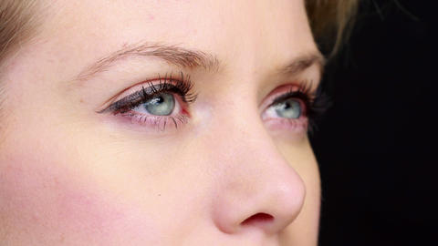 Pretty girl with eyeliner blinking close up Stock Video Footage