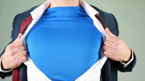 Businessman opening shirt in superhero style Footage