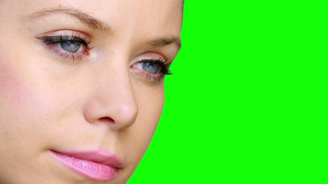 Pretty girl wearing eyeliner looking and smiling Stock Video Footage